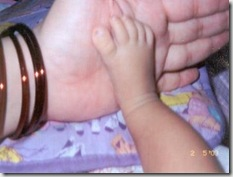 Palakshi's foot on her Mom's palm